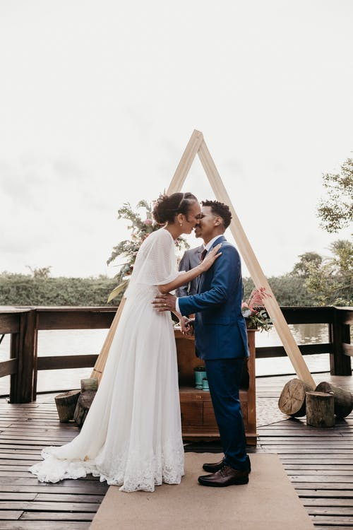 Diverse newlywed couple kissing on wedding day
