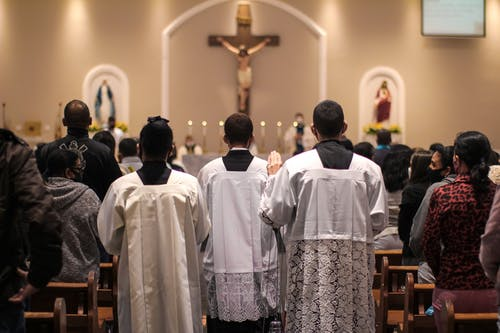 People in White Robe Standing in Church