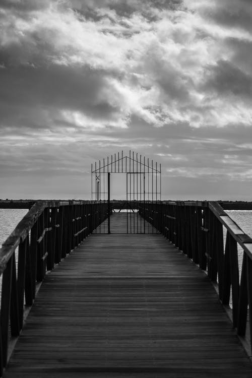 A Grayscale Photo of a Wooden Dock