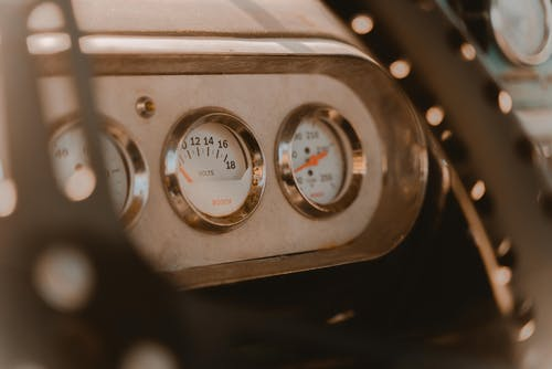 Silver and White Analog Gauge