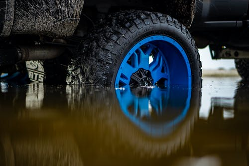 Blue and Black Car Wheel on Water