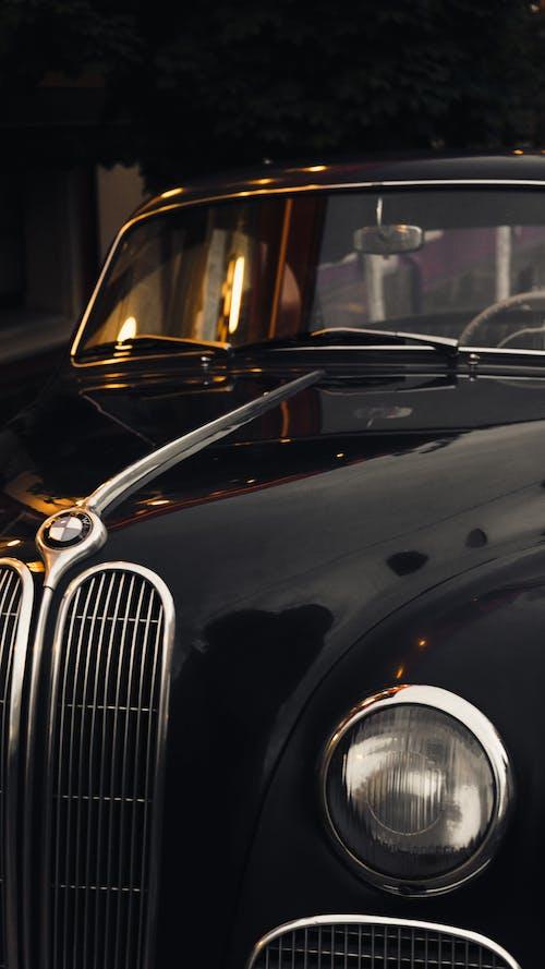 Luxury vintage black car parked in city street