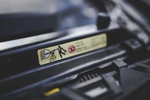 High voltage sign on a car's headlights. Xenon.