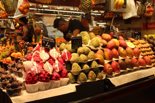 Variety of Fruits on Display in a Market