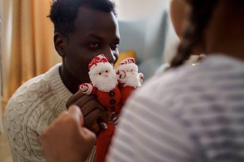 A Man Holding a Red Santa Claus Socks