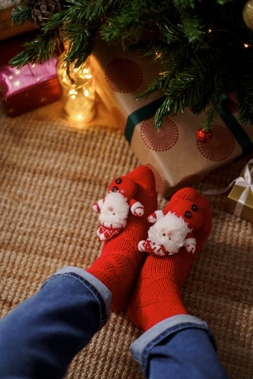 Person Wearing Red Christmas Socks