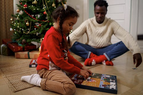 Dad and Daughter Playing an Advent Calendar Game