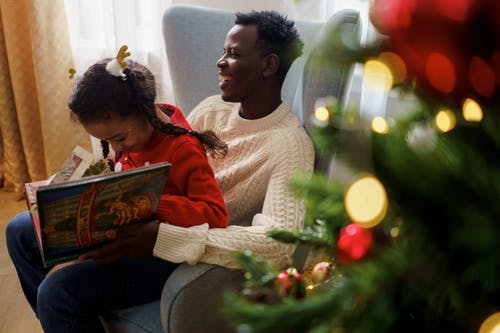Dad and Daughter Having Fun While Reading a Fairy Tale Book