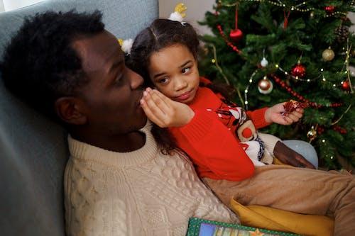 A Girl Feeding Her Dad