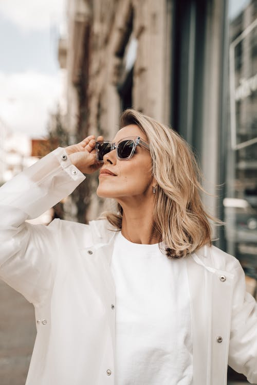 Stylish woman in sunglasses on city street