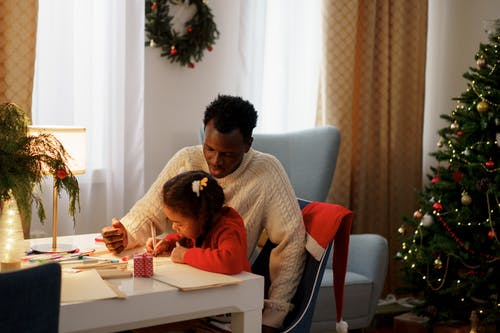 Dad Watching Her Daughter Make a Christmas Letter