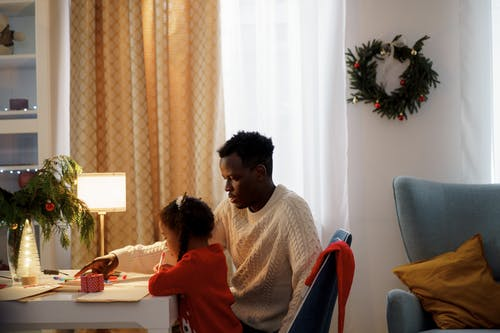 Dad Teaching Her Daughter Make a Christmas Letter