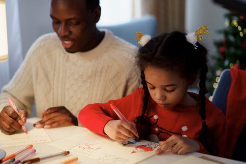 Dad and Daughter Making a Christmas Letter