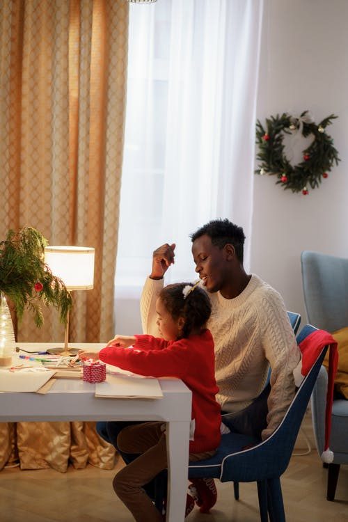 A Dad Watching Her Daughter Make a Christmas Letter