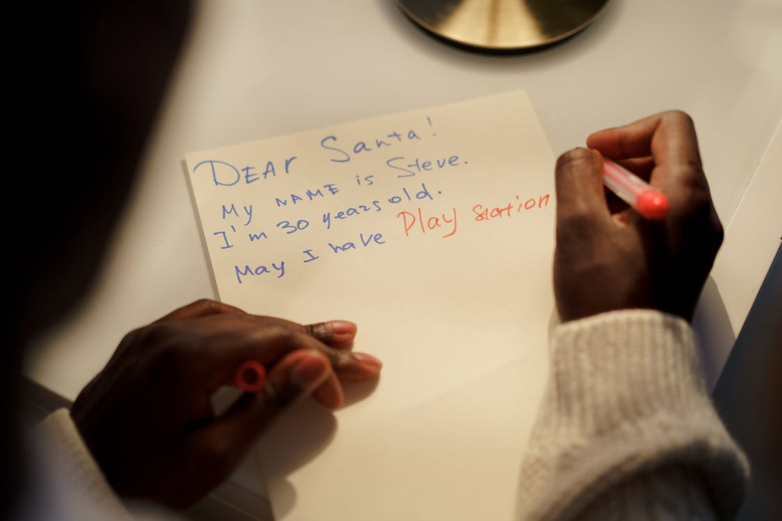 A Person Writing His Wish List