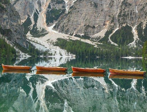 Brown Boat on Lake