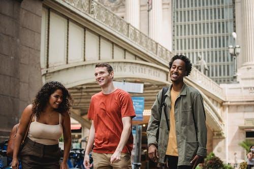 Happy multiethnic friends on street