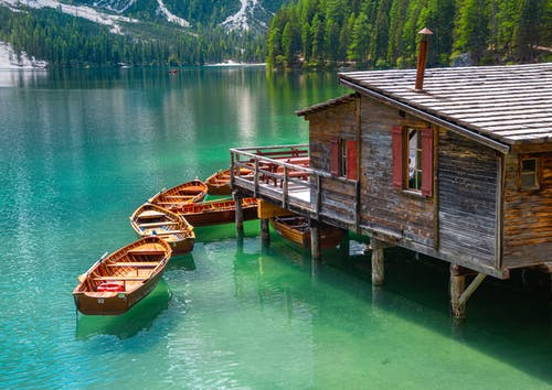 Brown Wooden Boat on Green Water