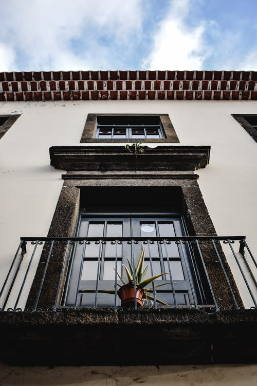 Low-Angle Shot of a Balcony of a Concrete Building