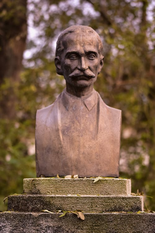 Bust of man in park