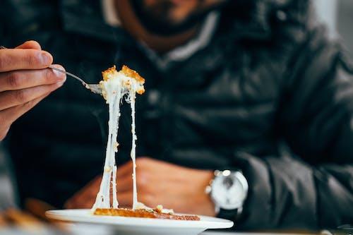 Kostenloses Stock Foto zu erwachsener, essen, fokus