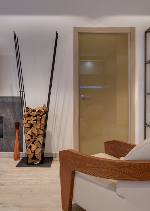 Interior of modern lounge with rack for firewood
