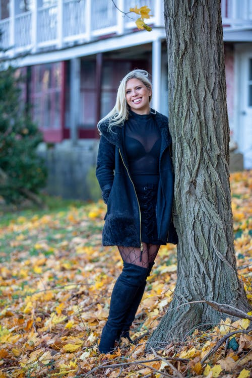 Woman in Black Jacket Standing Beside Tree