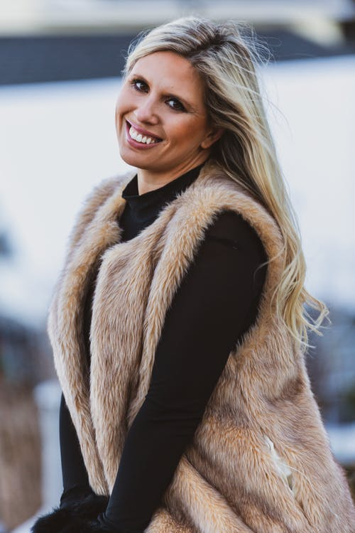 Woman in Brown and White Fur Coat