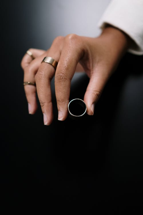 Close-Up Shot of a Person Holding a Ring