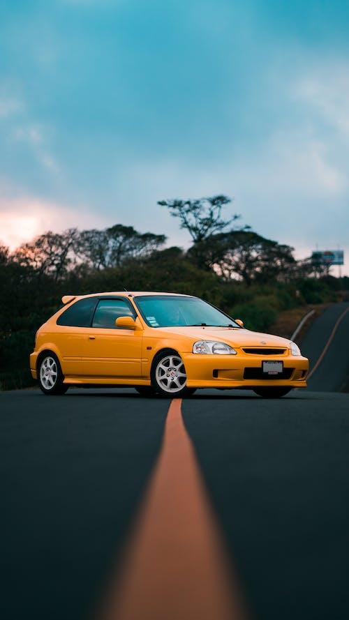 Yellow Sedan on the Road