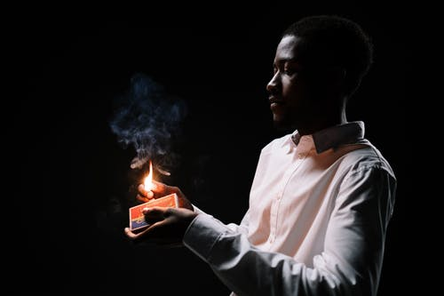 A Man Holding a Burning Match Stick
