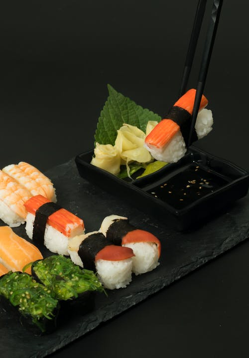 Sushi on Black Rectangular Plate
