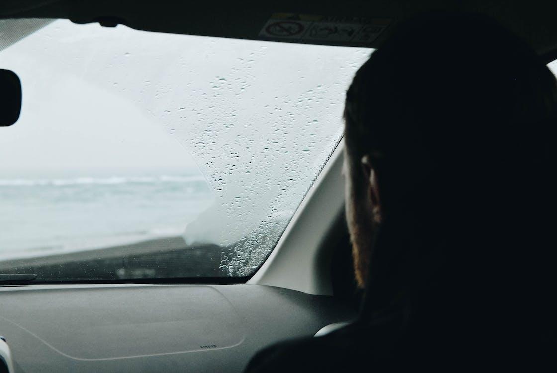 Person Sitting Inside Car