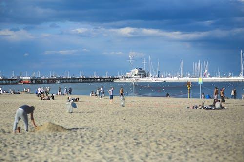 People on the beach. Pier & marina
