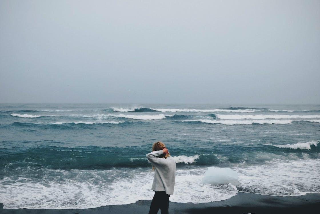 Woman Walking Beside Seashore
