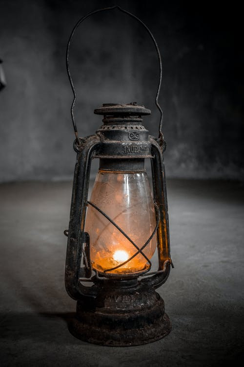 Black and Brown Lantern on Table