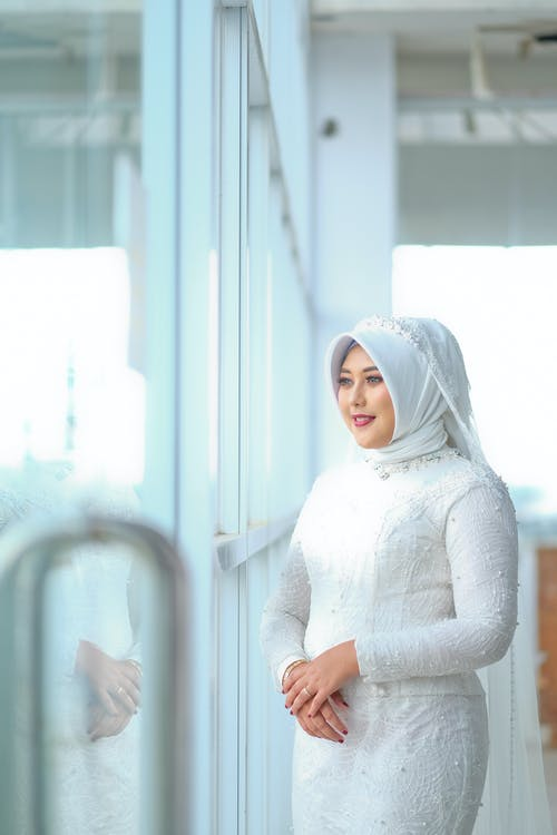 Woman in White Long Sleeve Shirt and White Hijab