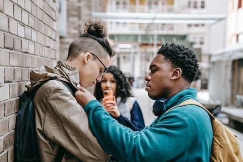 Black man grabbing student near university