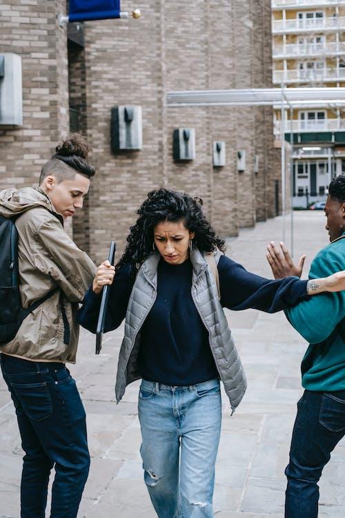 Multiethnic students bullying classmate near university