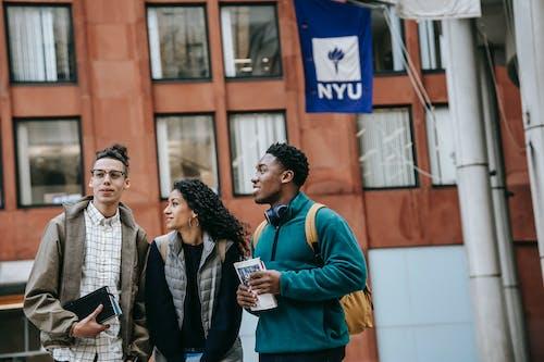 Group of multiethnic students standing near university
