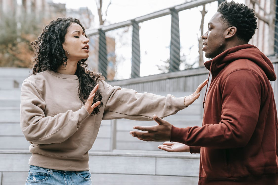 Multiracial couple having conflict on street