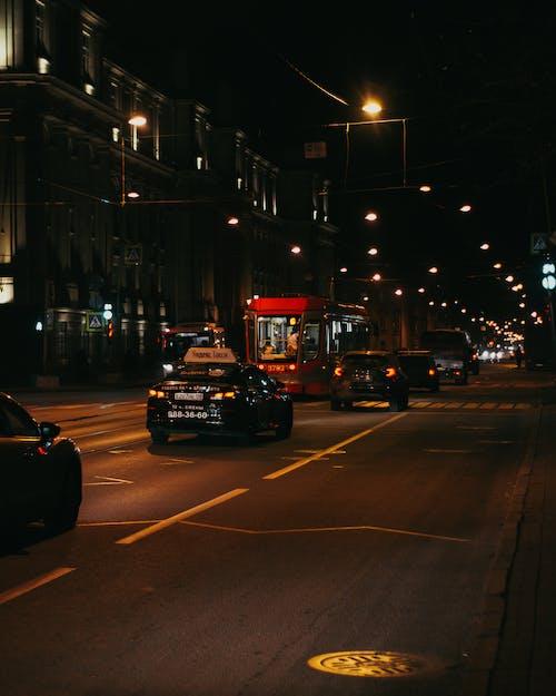 Traffic on modern city street at night