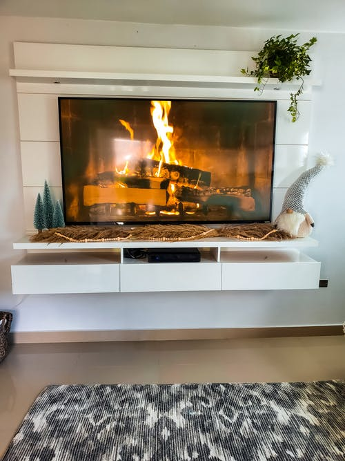 White Fireplace With White Wooden Frame