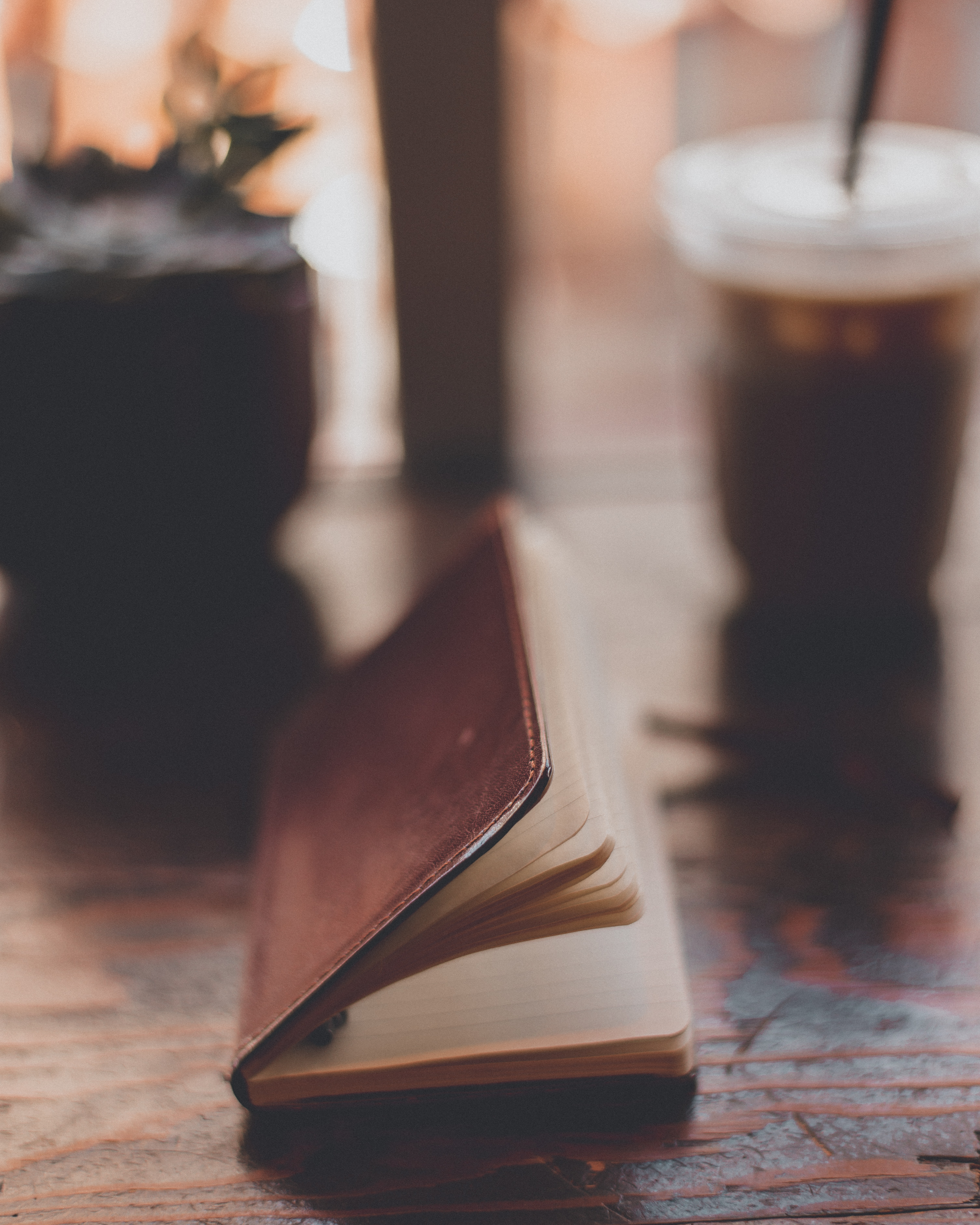 Brown Leather Book on Brown Wooden Surface