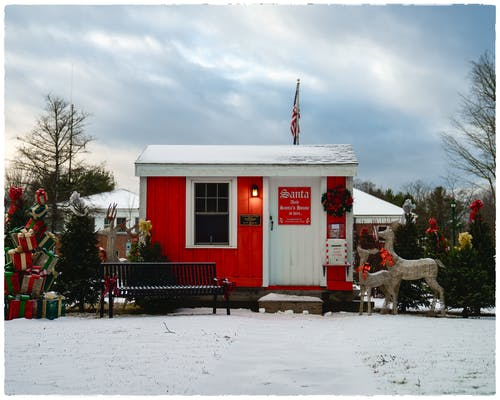 Small modern Santa house with USA flag and festive decorations
