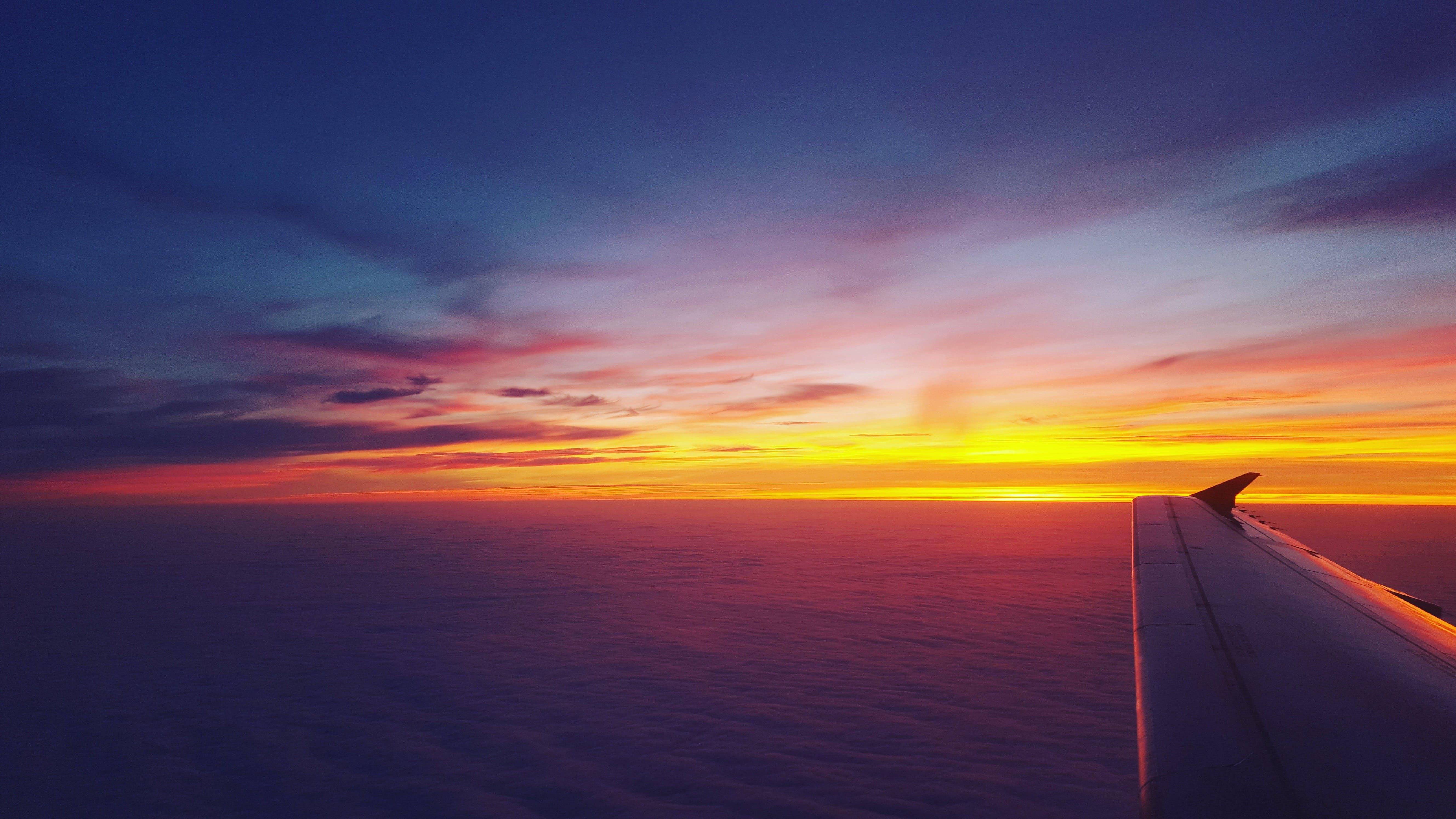 Безкоштовне стокове фото на тему «Авіація, вода, горизонт, Захід сонця»