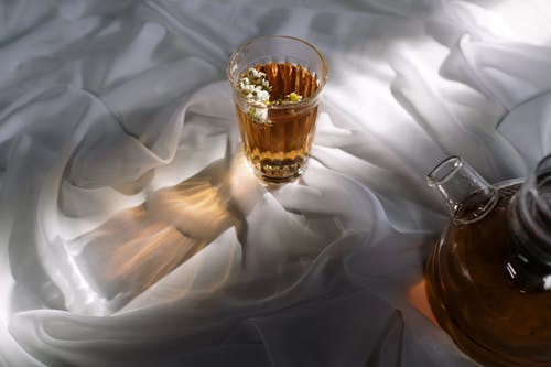 Clear Shot Glass on White Textile