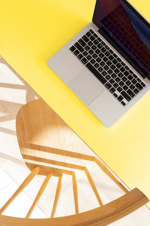 Macbook Pro on Yellow Table