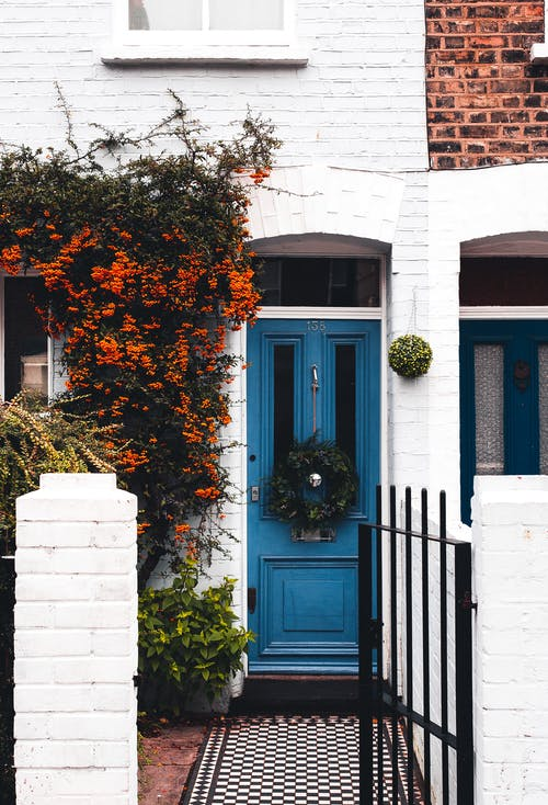 Blue Wooden Door in White Townhouse