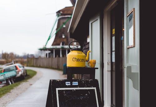 Yellow kettle with small mug